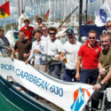 The crew celebrate their arrival in Falmouth Harbour, Antigua