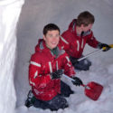Kyran Young and Alex Schranz at the early stages of a snowhole