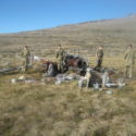 Examining the remains of an Argentinian Chinook helicopter
