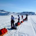 The team having a water break while crossing the sea ice in the bay. Ittoqqortoormit is approx 5km in the distance
