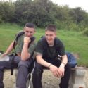 Cadets RSM Edwards and CSM Selby sitting on the refurbished bench.