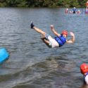 Flight Sergeant South taking a dive from a canoe.
