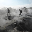 Crossing a lava field between steaming vents