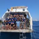 Group photo of Ex Cabot Coral participants on board M/Y Cyclone