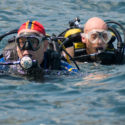 Tony Overbury (L) and Tony Hughes return from their dive on HMS Maori in Valetta Harbour.