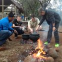 Kieran Walker, Todd Cross-Watson and Liam Holland-Bunch prepare a Potjie for the group's evening meal