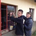 Ben Davis and Fraser Merrick replacing one of the 27 broken windows fixed by the group in a local school