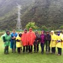 The group with colourful wet weather gear.