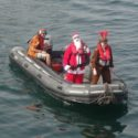 Santa trades in his sleigh for a powerboat