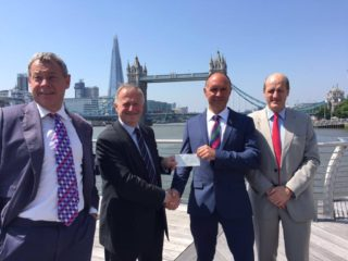 AVM NIck Kurth CBE presents WO1 Lou Rudd with the second half of the Ulysses Trust £30K donation.  Image also features Ian Hannam (left) and Dr Rod Stables, Ulysses Trust Trustee (right).