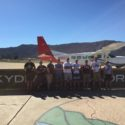Group photo in front of the Skydive Elsinore 'Red Caravan'