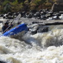 Two cadets successfully negotiate a rapid on the Tugela River
