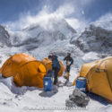 Preparing kit at basecamp with the Khumbu icefall in the background