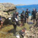The novice divers about to enter the open water through a 'blow hole' in the rock formation during Ex NEPTUNE SERPENT 17