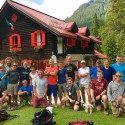 Expedition members, and friends we had made over the first four days.  In the background, Rifufio Padova; we stayed here on our first night.